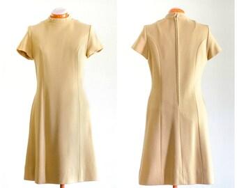 1960s ochre wool short sleeve a line dress with pockets