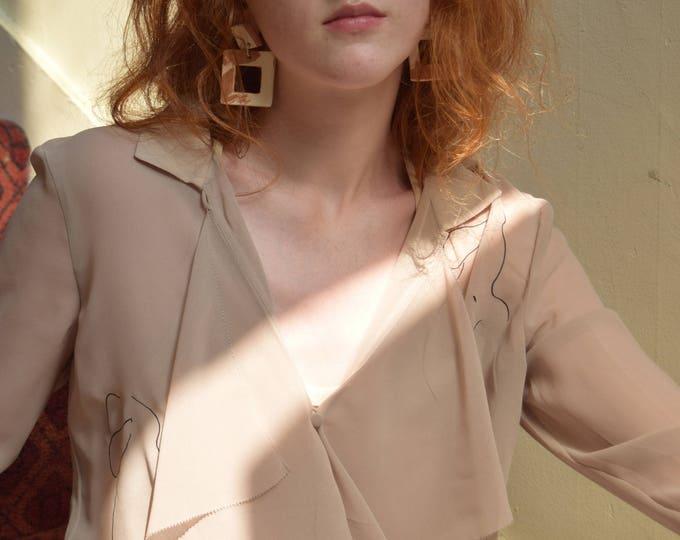 audrey sheer ruffle blouse.
