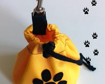 Yellow dog treat pouch with a paw
