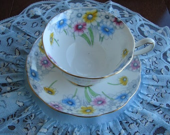 1920s Royal Albert Crown China Made in England - Vintage Tea Cup and Saucer - Avon Shaped. Multicolored Daisies with Gold Trim