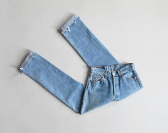levis 501 jeans / 28 waist / vintage high waist button fly jeans with raw hem / made in usa