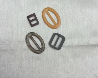 Group of 4 vintage retro belt buckles in mixed colours from 1970s