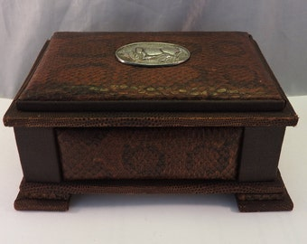 A snakeskin box with 925 silver plaque