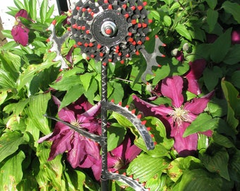 Steampunkish garden or wall flower from repurposed bicycle parts.