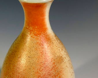Wood fired porcelain bottle, celadon glaze