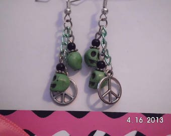 Green skulls w/charm earrings.