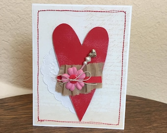 Valentine card homemade; Valentine card with red heart;