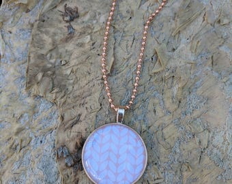 Rose Gold and pink round pendant on a rose gold plated necklace.