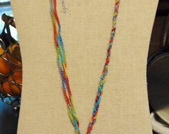 Tie dye crochet peace sign necklace.