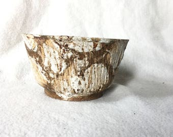 Small vintage flower pot, coarse. Light brown with white spots