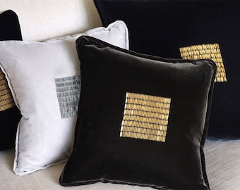 Velvet pillows with hand beaded metal paillettes. Made in Italy.