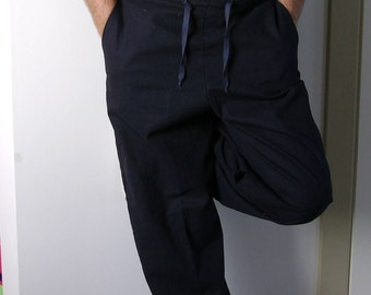 Men's linen trousers with pockets, belt - back with rubber, front smooth with a drawn twine.