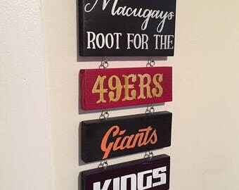 The [Family Name] Roots For The... (Hanging Sign/Multiple Teams)