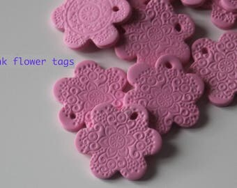 Pink flower tags or disks (3x)