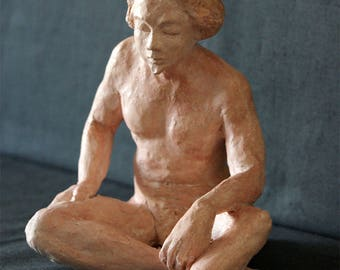 Naked man sitting at the goatee - figurative sculpture