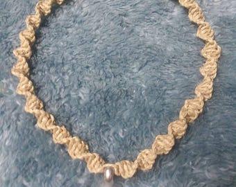 Hemp choker with tri-quetra pendant