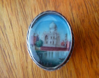 Hand painted Taj Mahal underglass with silver back button (1890).