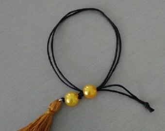 Bracelet cotton thread and tassel ocher
