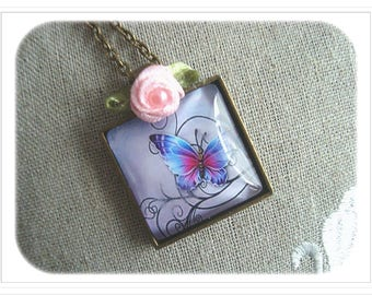 Bronze cabochon pendant, butterfly and Arabesque.