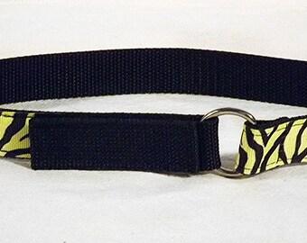 Yellow tiger print toddler belt on black nylon web