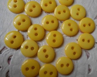 Yellow round acrylic 2 buttons holes 9 mm in diameter (with 20 buttons).