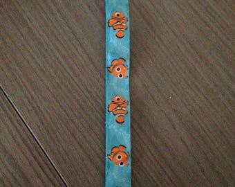 Orange fish pacifier clip