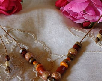 adjustable painted necklace modeled in clay and painted Central bead: sweet pig