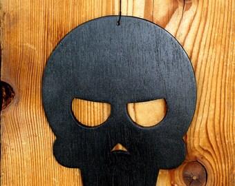 Black painted skull pendant