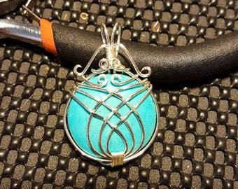 Handmade wire wrapped pendant in silver plated copper wire and turquoise.