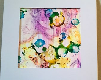Eye Spy an abstract alcohol ink painting on Yupo 18cm x18cm in white card mount