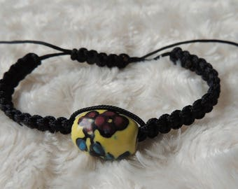 Black macrame bracelet with ceramic floral bead