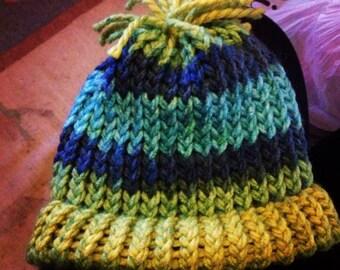 Adorable children's knit hat with pom-pom