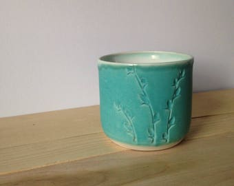 Handmade thrown and carved porcelain carved cup