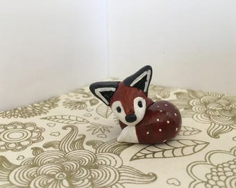 curled fox clay animal totem