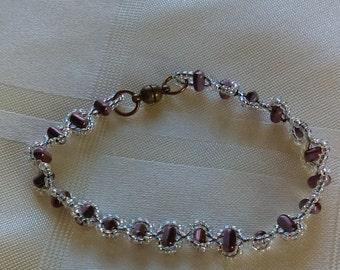 Amethyst and crystal  AB coated seed bead bracelet