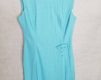 Women's 1960s light blue, sleeveless dress with back zip, bow and button accent on one side in front