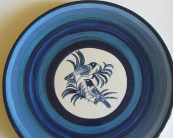 Ceramic in different shades of blue with a bird motif