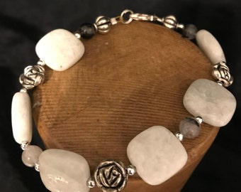 White howolite beaded bracelet with silver accents.