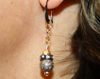 Gunmetal and gold earrings with sparkly gunmetal and gold beads and rhinestones.