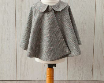 Light woollen tweed cape with blue silk lining