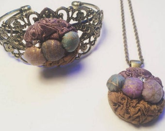 Beautiful Ornate Textile Bracelet and Textile Pendant Necklace Set with Purple and Golds