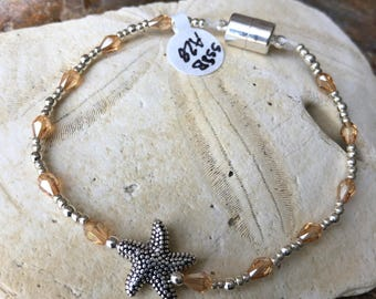 Simple sliver starfish accented with silver and faceted beige beading