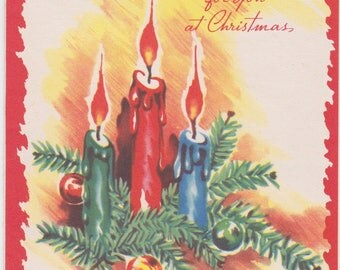 1940s vintage Christmas card with colorful candles and greenery; used but in great condition