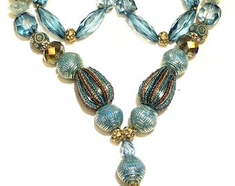 Blue and gold beads with jumkha locket style long neck piece.