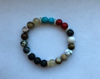 Beaded bracelet with lava rock bead diffusers