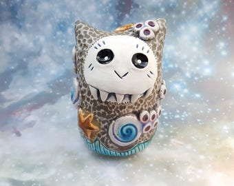 Ceramic Monster with Ocean Themed Decorations