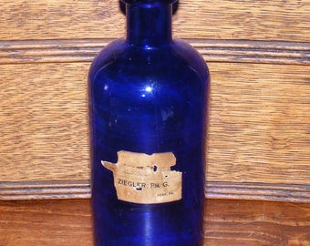 Antique Cobalt Blue Glass Pharmacy or Apothecary Bottle Partial sepia label Ziegler York Pa