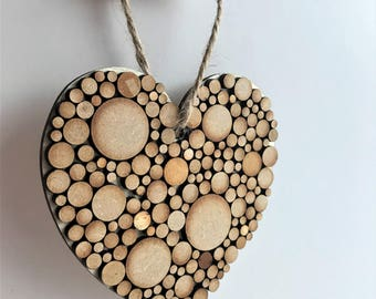 Wooden heart with wooden circle detail