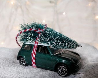 Green Mini Car with Tree Strapped to the Top Ornament by Distinguished Flamingo