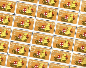 20 pieces - 1981 20 cent Season's Greetings bear on sled - Vintage unused stamps - great for Christmas, holiday cards